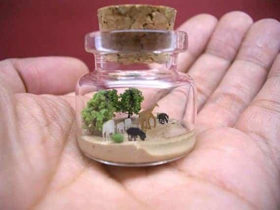 giraffe-elephant-horse-rhinoceros-ostrich-deer-inside-a-tiny-bottle